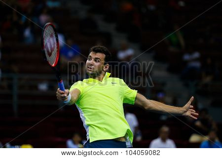KUALA LUMPUR, MALAYSIA - OCTOBER 01, 2015:Grigor Dimitrov of Bulgaria reacts after a backhand return in his match at the Malaysian Open 2015 Tennis tournament held at the Putra Stadium, Malaysia.