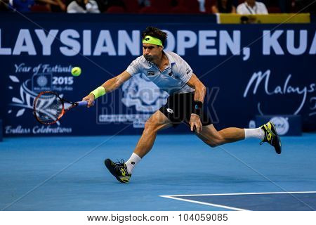 KUALA LUMPUR, MALAYSIA - OCTOBER 01, 2015: David Ferrer of Spain chases a forehand return in his match at the Malaysian Open 2015 Tennis tournament held at the Putra Stadium, Malaysia.