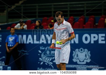 KUALA LUMPUR, MALAYSIA - OCTOBER 01, 2015: Radek Stepanek of the Czech Republic prepares to serve in his match at the Malaysian Open 2015 Tennis tournament held at the Putra Stadium, Malaysia.