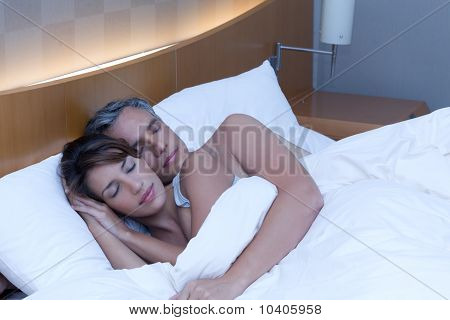 A Man And Woman Sleeping Comfortably