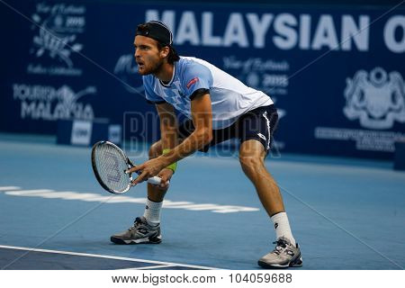 KUALA LUMPUR, MALAYSIA - OCTOBER 01, 2015: Joao Sousa of Portugal waits for a service return during his match at the Malaysian Open 2015 Tennis tournament held at the Putra Stadium, Malaysia.