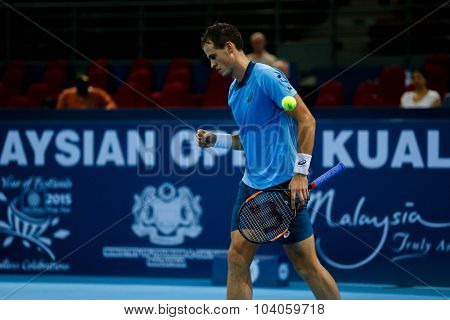 KUALA LUMPUR, MALAYSIA - OCTOBER 01, 2015: Vasek Pospisil of Canada reacts after scoring a point during his match at the Malaysian Open 2015 Tennis tournament held at the Putra Stadium, Malaysia.