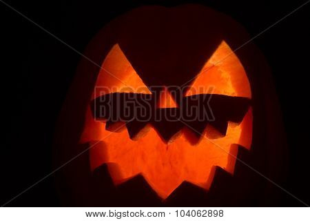 Smiling Face Of Jack Of The Lantern On Black