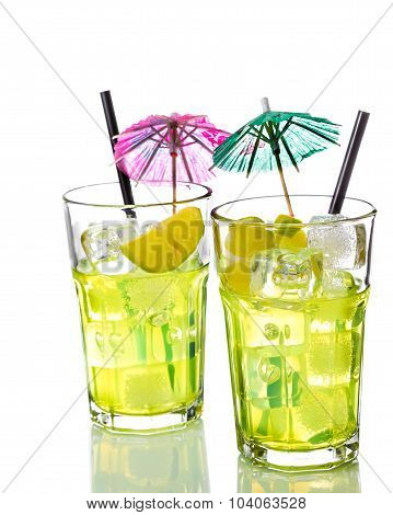 Two Glasses With Cocktail And Ice With Lime Slice On White Background
