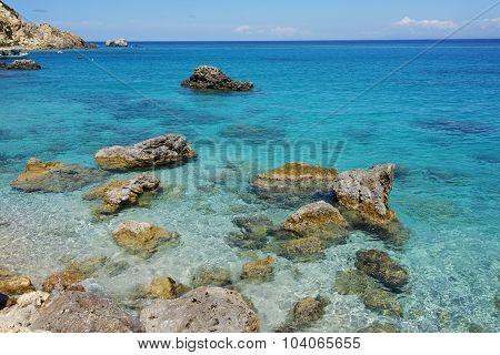 Rock in the water of Agios Nikitas Beach, Lefkada