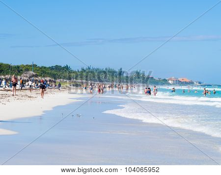 VARADERO,CUBA - OCTOBER 4, 2015 : Tourists enjoying the beautiful beach of Varadero in Cuba