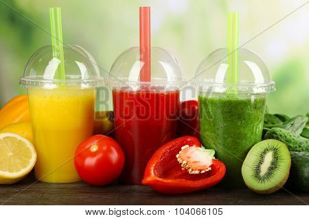 Fresh juice mix fruit, healthy drinks on wooden table, on bright background