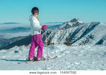Happiness female at ski stay on the beautiful mountains view