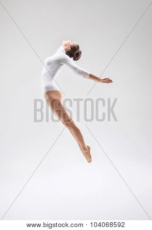 Jumping girl in the studio