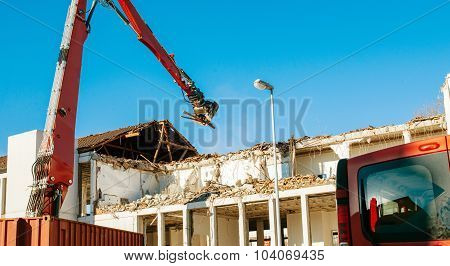Building Demolition By A Heavy Twisted Rebars Industrial Truck