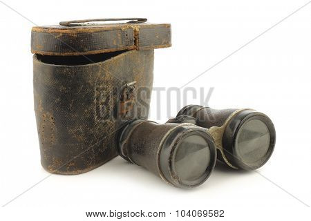 old binoculars with a case on white background