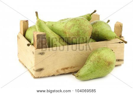 fresh juicy conference pears in a wooden box on a white background