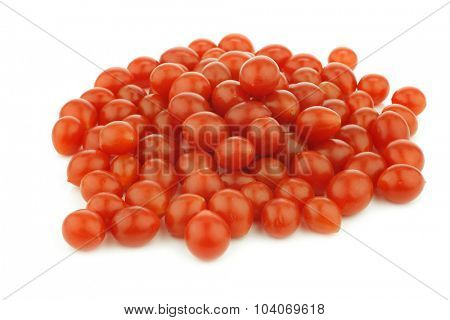 fresh tomberry tomatoes (very small) on a white background