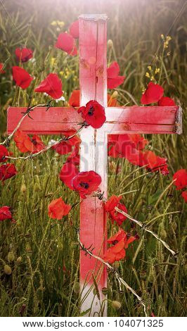 Remembrance Day - Wooden Cross With Poppies And Barb Wire