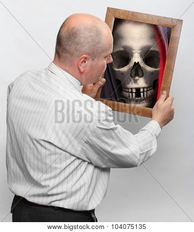 Senior and mirror with Grim Reaper's face. End of life concept.