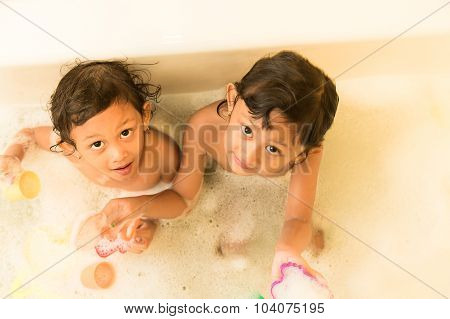 Asian Children Happy Playing Together In The Bathtub