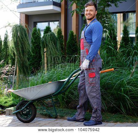 Gardener with tools in garden