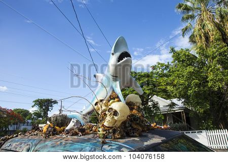 Car With A Sculpture Of A Shark And Skull And Plastic Shells On The Roof
