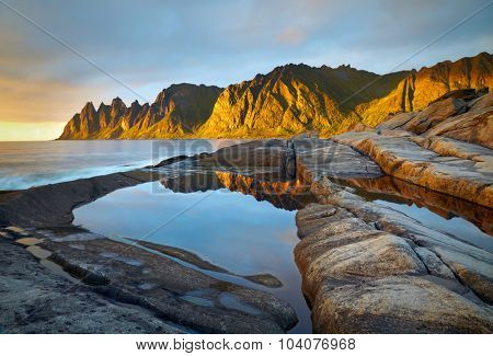 Peaks of the Okshornan mountain in sunset lights. Senja island, Norway