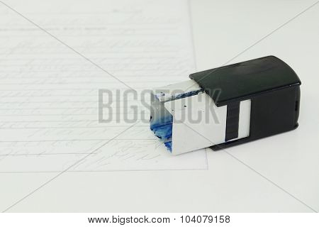 The image of a stamp on a table