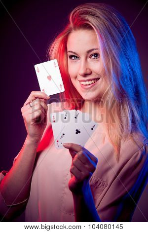 Beautiful caucasian woman holding poker cards and smiling