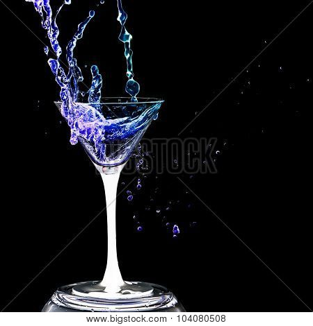 Cocktail Glass With Splashes On A Black Background.