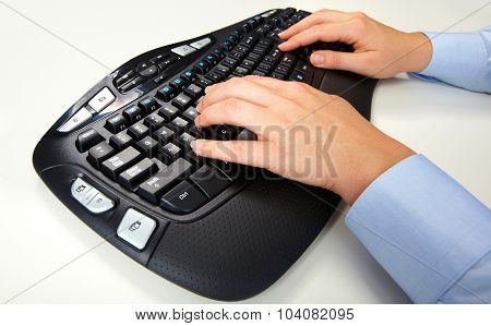 Hands of business woman typing on computer keyboard. Isolated white.