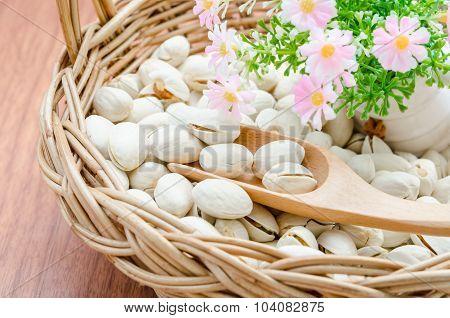 Pistachio Nuts In Wood Basket.