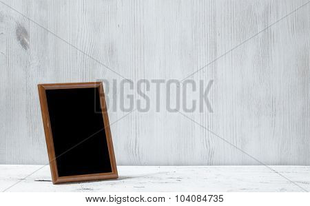 photo frame on old white table