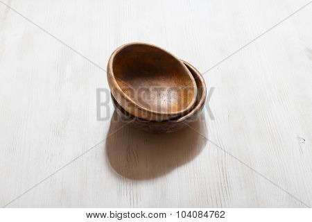 empty wooden bowls on white table