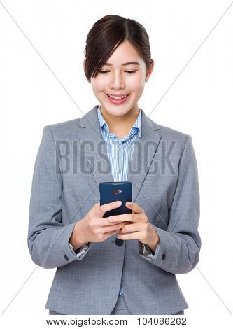 Asian Young Businesswoman use of the mobile phone