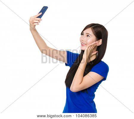 Asian woman take self photo by mobile phone