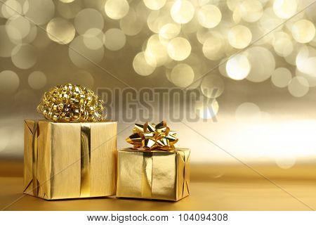 Golden gift boxes on abstract background
