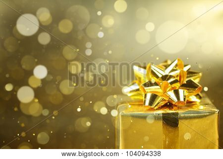 Golden gift boxes on abstract background,Closeup.
