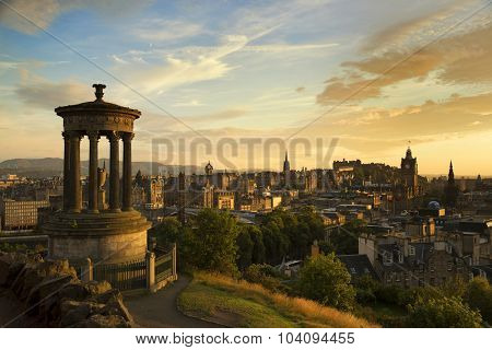 View of Edinburgh city and Scott monument during sunset hour from Carlton Hill
