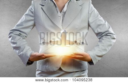 Close up of businesswoman hands holding airplane sign