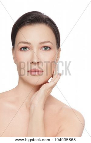Beautiful healthy mature woman touching her face, over white background