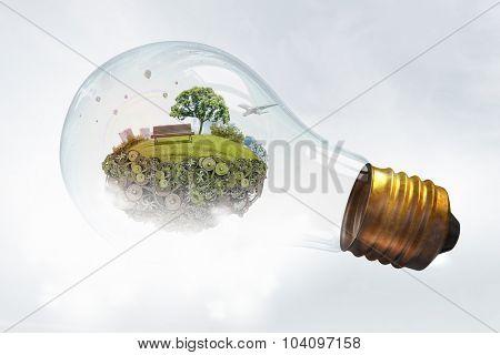 Eco life and energy saving concept in glass light bulb