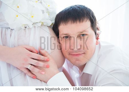 Future Happy Dad Hugging Pregnant Belly, Close-up Portrait