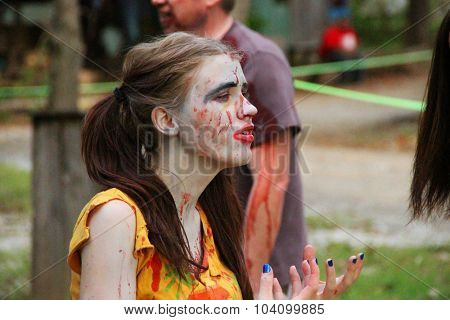 MUSKOGEE, OK - Sept. 12: A bloody zombie is posing for a picture during the Castle Zombie Run at the Castle of Muskogee in Muskogee, OK on September 12, 2015.