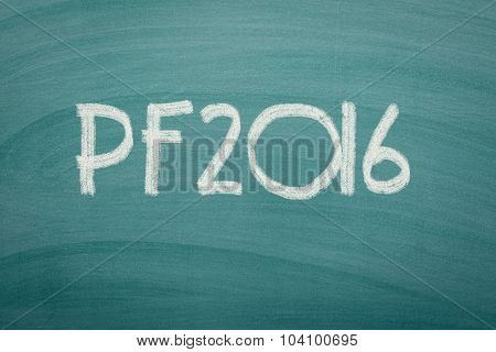 Happy new year 2016 written on green chalkboard.