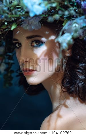 Close-up Portrait Of A Beautiful Spring Girl With Wreath On Head