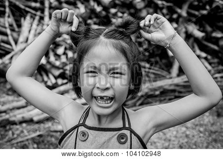Closeup Smiling Little Asian Girl With A Broken Teeth