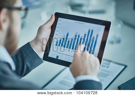 Businessman analyzing chart and graph showing changes on the market