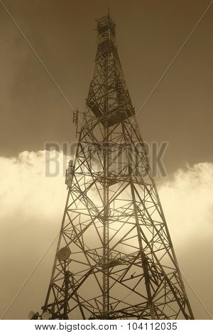Communication Antennae On A Misty Day In Warm Tone