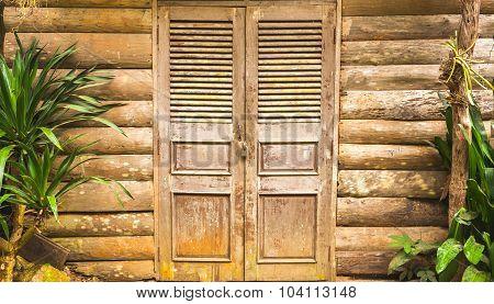 Old Wooden Barn Door And Wood Wall