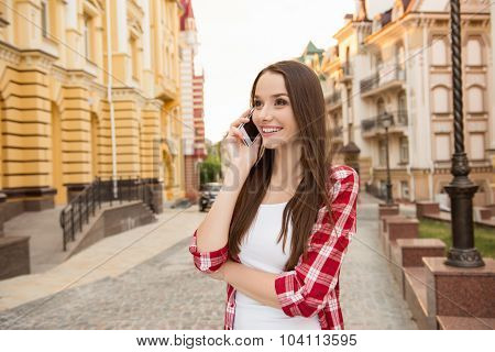 Nice Happy Girl Talking On The Phone On The Street