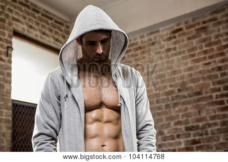Serious man in hood at the gym