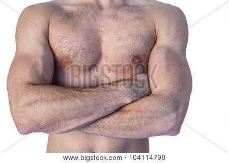 Midsection of a man with arms crossed over white background