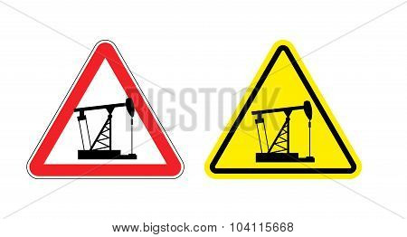 Warning Sign Of Attention To Pump Oil. Hazard Yellow Sign Fuel Production. An Oil Rig On  Red Triang